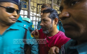 Jabale Nur Paribahan bus assistant Enayet Hossain arrives in court ahead of the verdict in a case over a road crash that killed two college students in 2018. He was subsequently acquitted by the court. Photo: Asif Mahmud Ove