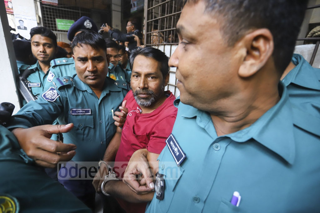 Police escorting Enayet Hossain, the assistant to a bus driver of Jabale Nur Paribahan, after a court in Dhaka acquitted him of charges related to the deaths of two college students in a road crash that triggered widespread protests. Photo: Asif Mahmud Ove