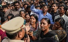 Demonstrators argue with a police officer during a protest against the alleged rape and murder of a 27-year-old woman in Shadnagar, on the outskirts of Hyderabad, India, Nov 30, 2019. REUTERS