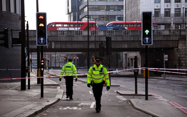 Police officers patrolling near London Bridge on Saturday, after a deadly attack by a man armed with knives. The New York Times