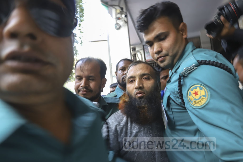 Police escorting Jabale Nur Paribahan bus driver Masum Billah from the court to jail in Dhaka on Sunday after he gets life imprisonment for the deaths of two college students in a road crash that triggered widespread protests. Photo: Asif Mahmud Ove