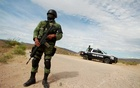 FILE PHOTO: A soldier assigned to the National Guard is pictured at a checkpoint as part of an ongoing security operation by the federal government near the Mexican-American Mormon community of La Mora, Sonora state, Mexico Nov 6, 2019. REUTERS