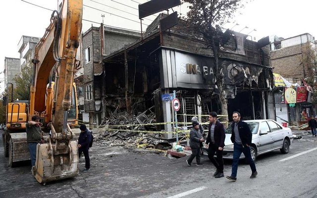 A burned bank after protests against increased fuel prices in Tehran last month. The New York Times