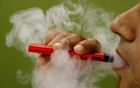 A man uses a vaping device in this illustrative picture. REUTERS