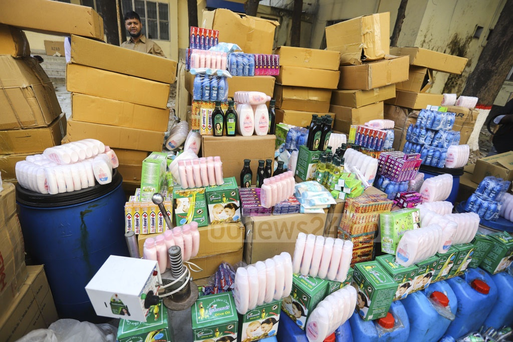 Bangladesh Standards and Testing Institution seized and destroyed a huge cache of counterfeit cosmetics and other products wrapped as imported goods in a drive on warehouses in Old Daka on Tuesday. Photo: Asif Mahmud Ove