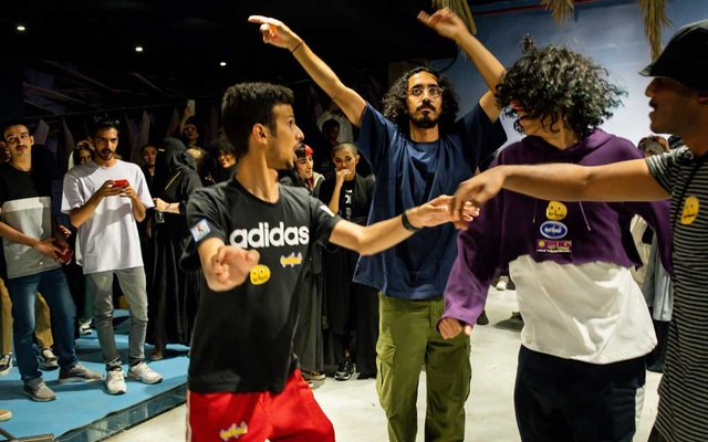 Mohammed Alhamdan, third from left, dancing with friends at a pop-up shop event in Riyadh, Saudi Arabia on Oct 10, 2019. The New York Times