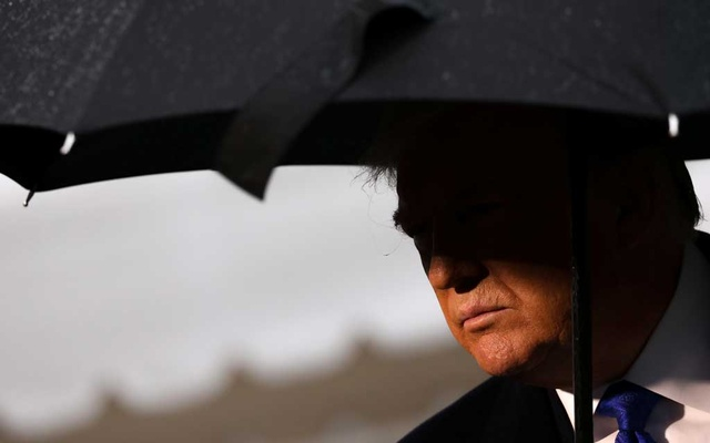 US President Donald Trump speaks to reporters as he and first lady Melania Trump depart for travel to a NATO summit in London, from the White House in Washington, US December 2, 2019. Reuters