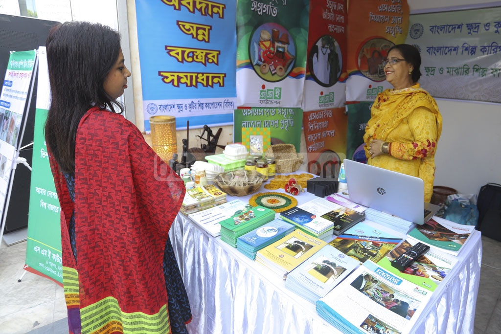 People visit a stall at Bangladesh Social Security Conference and Knowledge Fair 2019 organised by the Cabinet Division at Bangabandhu Sheikh Mujibur Rahman Novo Theatre in Dhaka on Wednesday. Photo: Asif Mahmud Ove