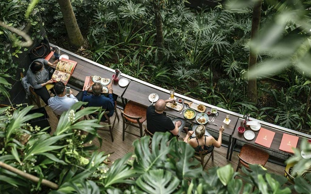 Dining in the Shiseido Forest Valley in the Jewel complex at Singapore Changi Airport, Nov. 6, 2019. With a soaring waterfall, forests, endless shops and restaurants, and even a sound-and-light show, a few hours' layover in Changi Airport may not be enough time. (Lauryn Ishak/The New York Times)