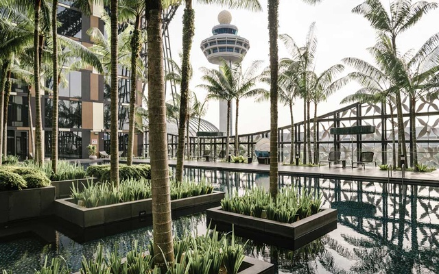 The Crowne Plaza at Singapore Changi Airport, Nov. 6, 2019. With a soaring waterfall, forests, endless shops and restaurants, and even a sound-and-light show, a few hours' layover in Changi Airport may not be enough time. (Lauryn Ishak/The New York Times)