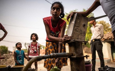 Filling water buckets from a governmental water pump in the drought-ravaged Lamhata village in Uttar Pradesh, India on Jun 11, 2019. The New York Times.
