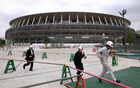 Workers at the construction site of the New National Stadium, a main venue of the 2020 Tokyo Olympics. The New York Times