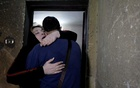 Palestinian journalist, Amjad Yaghi, hugs his mother, Nevine Zouheir, after 20 years of separation, in Banha, Egypt December 2, 2019. Reuters