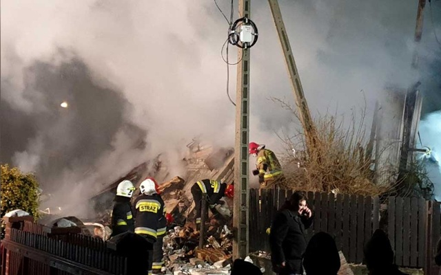 Firefighters work at the site of a building, levelled by a gas explosion, in the ski resort town of Szczyrk, Poland Dec 4, 2019 in this image obtained from social media. REUTERS