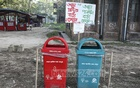 The authorities have installed different coloured bins to indicate different types of waste -- blue for biodegradable waste and red for non-biodegradable plastic waste -- on an experimental basis at Jahangirnagar University campus on Sunday. Photo: Mostafigur Rahman