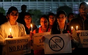 Resident doctors and medical students from All India Institute Of Medical Sciences (AIIMS) attend a candle-lit march to protest against the alleged rape and murder of a 27-year-old woman on the outskirts of Hyderabad, in New Delhi, India, December 3, 2019. REUTERS