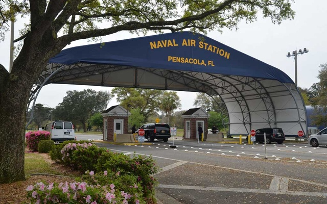 The main gate at Naval Air Station Pensacola is seen on Navy Boulevard in Pensacola, Florida, US March 16, 2016. Picture taken March 16, 2016. US Navy/Patrick Nichols/Handout via REUTERS