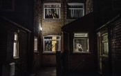 A woman prepares food in a home on a street of residences originally built for the families of miners — the local coal mine closed in 1993 — in Shirebrook, England, Nov. 17, 2019. As Britain heads for an election, a reporter's two-week tour across Britain found a country where, for all sorts of reasons, all sorts of people felt alienated and unmoored. (Laetitia Vancon/The New York Times)