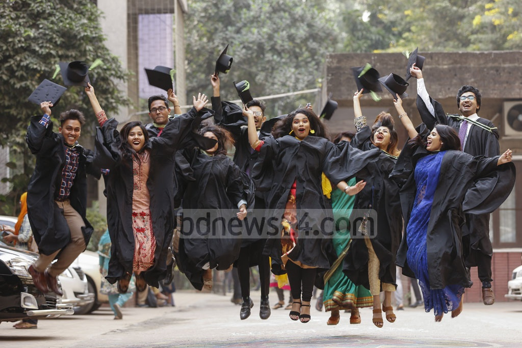 Dhaka University graduates clad in gowns and cap leap for joy to celebrate the convocation. Photo: Mahmud Zaman Ovi