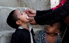 FILE PHOTO: A boy receives polio vaccine drops, during an anti-polio campaign, in a low-income neighbourhood in Karachi, Pakistan Apr 9, 2018. REUTERS