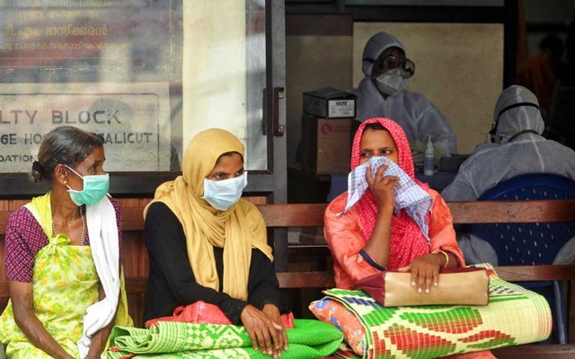 File Photo: People wear masks as they wait outside a casualty ward at a hospital in Kozhikode in the southern state of Kerala, India, May 23, 2018. REUTERS