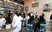 File Photo: Women sit among men in a newly opened cafe in Khobar, Saudi Arabia, Aug 2, 2019. REUTERS