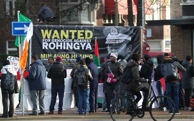 People protest outside the International Court of Justice (ICJ) during a hearing in a case filed by Gambia against Myanmar alleging genocide against the minority Muslim Rohingya population, in The Hague, Netherlands December 10, 2019. Reuters
