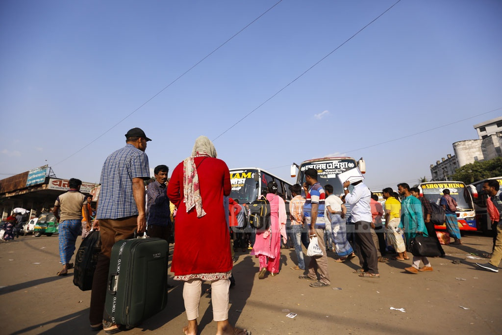 Passengers waiting for a ride at the Dhaka's Mohakhali terminal amid an ongoing bus strike enforced by transport owners on the Mymensingh route. Photo: Mahmud Zaman Ovi