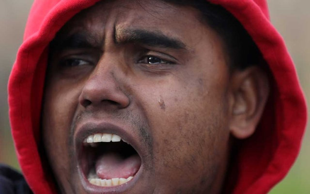 A man cries as he takes part in a protest outside the International Court of Justice (ICJ) during a hearing in a case filed by Gambia against Myanmar alleging genocide against the minority Muslim Rohingya population, in The Hague, Netherlands December 10, 2019. Reuters