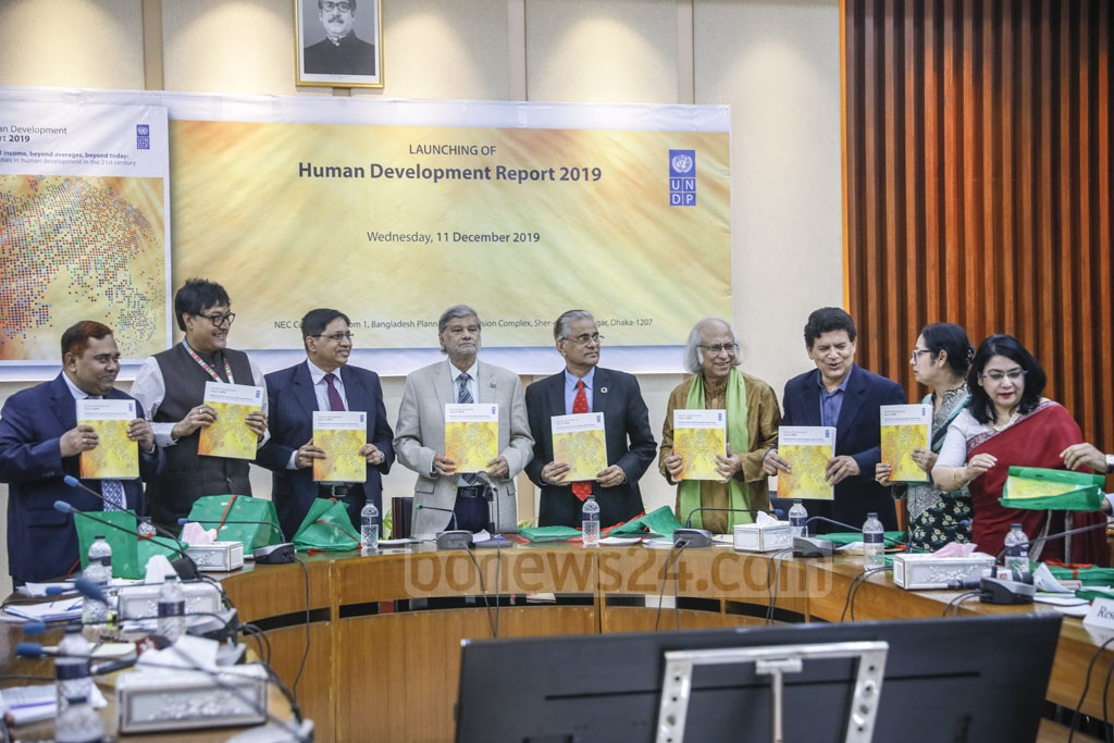 Planning Minister MA Mannan and others pose with the UNDP's Human Development Report-2019 in Dhaka on Wednesday. Photo: Asif Mahmud Ove