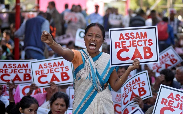 A woman shouts slogans during a protest against the Citizenship Amendment Bill, a bill approved by India's cabinet to give citizenship to religious minorities persecuted in neighboring Muslim countries, in Guwahati, India, December 5, 2019. REUTERS
