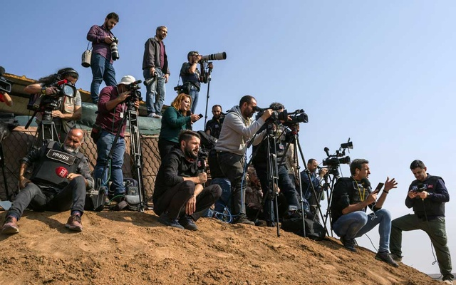 Turkish journalists report from a military observation outpost in southern the village of Sevimli, in southern Turkey, as Russian and Turkish forces began their first joint patrol inside Syria, Nov 1, 2019. In its annual survey, the Committee to Protect Journalists found that at least 250 journalists are imprisoned around the world, largely by authoritarian leaders. The New York Times
