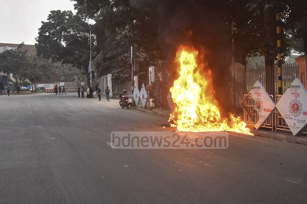 Unidentified miscreants set fire to a motorcycle amid tight security in front of the main gate of National Eidgah Ground in Dhaka on Wednesday, a day before the top court is to begin hearing the appeal for bail by BNP chief Khaleda Zia in a corruption case.