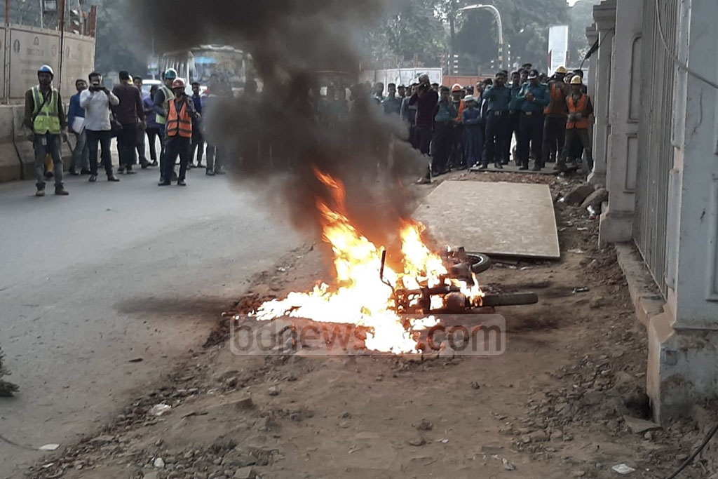 Unidentified miscreants set a motorcycle on fire amid tight security in the Supreme Court area on Wednesday, a day before the top court is set to begin hearing the bail plea of BNP chief Khaleda Zia in a corruption case.