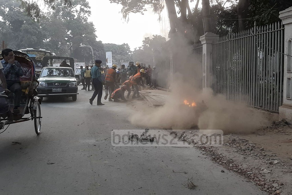Firefighters making efforts to douse the fire set on a motorcycle amid tight security in the Supreme Court area on Wednesday, a day before the top court is to begin hearing the bail plea by BNP chief Khaleda Zia in a corruption case.