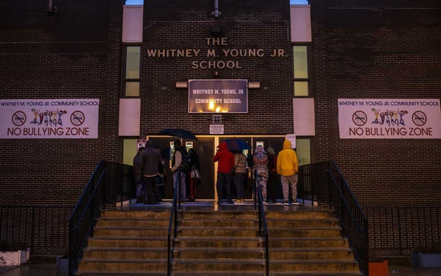 Parents wait to pick up children at the Whitney M Young Jr School, which was on lockdown after a shooting, in Jersey City, NJ, Dec 10, 2019. The New York Times