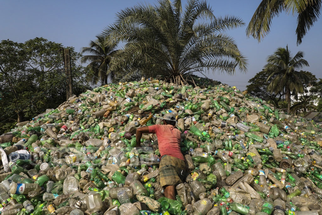 PET bottles pile up near a processing plant in Jashore in the wake of a ban on the import of plastic waste by China and India. Photo: Mostafigur Rahman