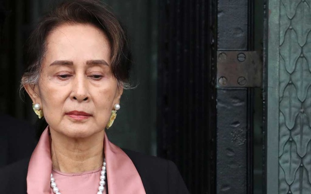 Myanmar's leader Aung San Suu Kyi leaves after attending a hearing in a case filed by Gambia against Myanmar alleging genocide against the minority Muslim Rohingya population, at the International Court of Justice (ICJ) in The Hague, Netherlands Dec 10, 2019. REUTERS