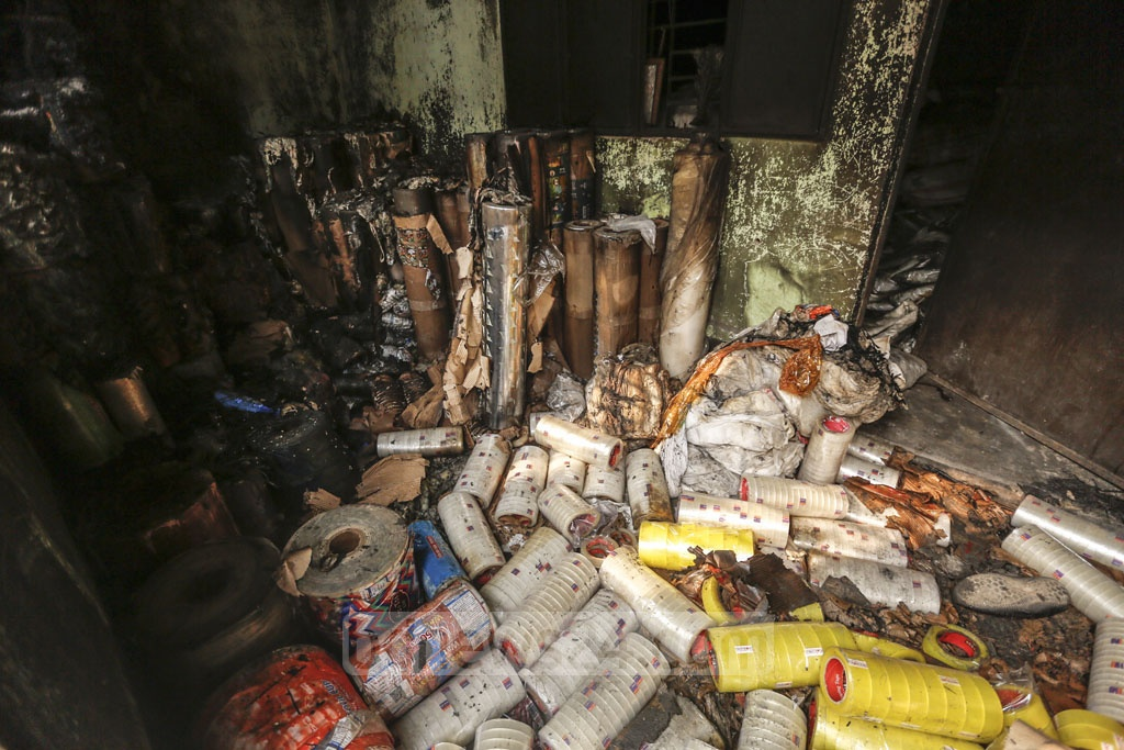 Plastic goods found dispersed on the floor after a fire swept through a factory named 'Prime Pet and Plastic Industries Limited' at Chunkutia in Dhaka's Keraniganj. Photo: Mahmud Zaman Ovi