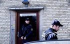File Photo: Policemen stand guard in an apartment block during a search for suspects believed to have travelled to Syria to join the Islamic State, in Tingbjerg, Copenhagen, April 7, 2016. Reuters
