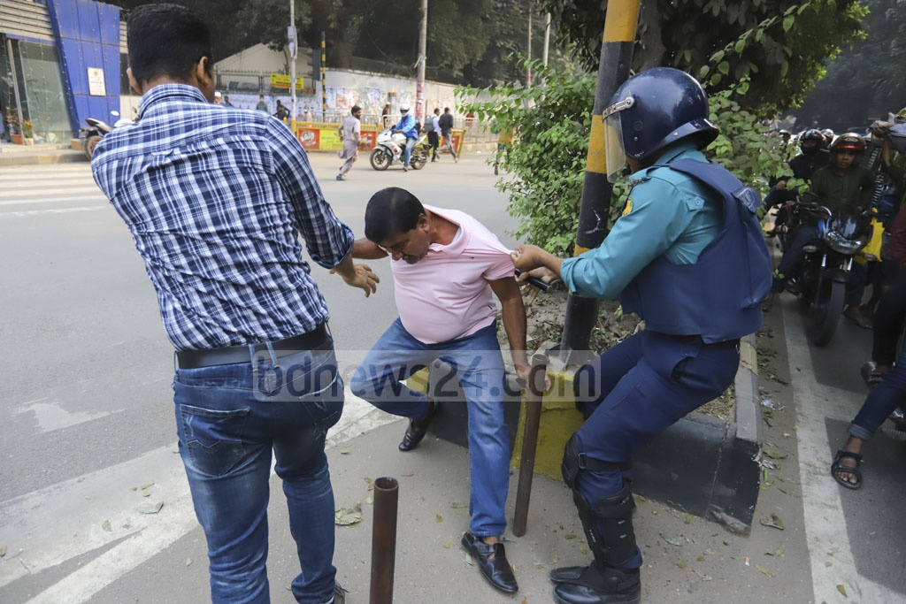 Police chased and detained two people after BNP leaders and activists shouted slogans in protest against the Supreme Court's decision to reject an appeal by party chief Khaleda Zia for bail in a graft case on Thursday.