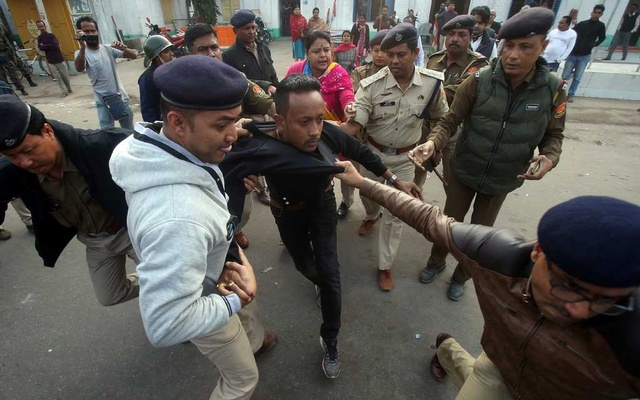 Policemen detain a demonstrator during a protest after India's parliament passed Citizenship Amendment Bill (CAB), in Agartala, India, Dec 12, 2019. REUTERS