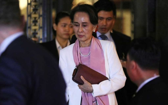 Myanmar's leader Aung San Suu Kyi leaves the International Court of Justice (ICJ), the top United Nations court, after court hearings in a case filed by Gambia against Myanmar alleging genocide against the minority Muslim Rohingya population, in The Hague, Netherlands December 12, 2019. Reuters