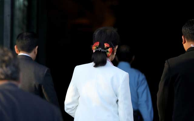 File Photo: Myanmar's leader Aung San Suu Kyi arrives at the International Court of Justice (ICJ), the top United Nations court, ahead of hearings in a case filed by Gambia against Myanmar alleging genocide against the minority Muslim Rohingya population, in The Hague, Netherlands Dec 12, 2019. REUTERS
