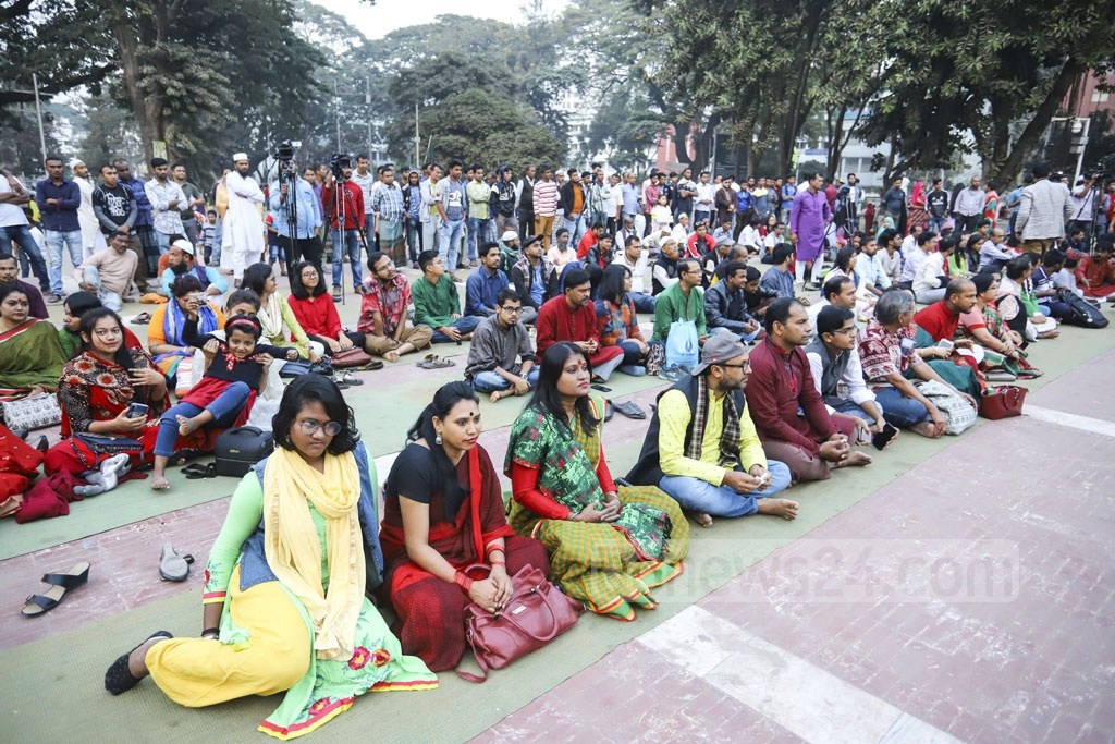 Visitors on the first day of the six-day Victory Day celebrations organised by Sammilita Sangskritik Jote at the Central Shaheed Minar in Dhaka on Friday. Photo: Asif Mahmud Ove