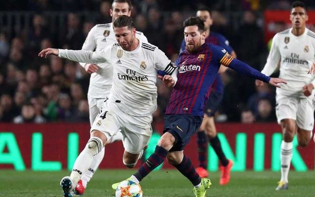 FILE PHOTO: Football - Copa del Rey - Semi Final First Leg - FC Barcelona v Real Madrid - Camp Nou, Barcelona, Spain - February 6, 2019. Real Madrid's Sergio Ramos in action with Barcelona's Lionel Messi. Reuters