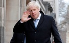 Britain's Prime Minister Boris Johnson waves as he arrives at a polling station, at the Methodist Central Hall, to vote in the general election in London, Britain, December 12, 2019. Reuters
