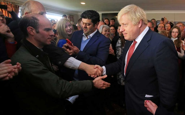 Britain's Prime Minister Boris Johnson shakes hands with supporters during a visit to see newly elected Conservative party MP for Sedgefield, Paul Howell at Sedgefield Cricket Club in County Durham, north east England on December 14, 2019, following his Conservative party's general election victory. Lindsey Parnaby/Pool via REUTERS
