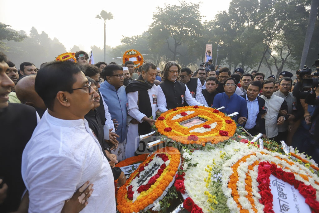 People from all walks of life pay tribute to the martyred intellectuals at the Martyred Intellectuals Memorial at Mirpur in Dhaka on Saturday. Photo: Asif Mahmud Ove
