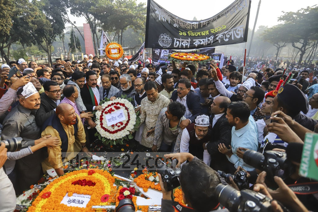 Jatiya Party leaders pay tribute to the martyred intellectuals at the Martyred Intellectuals Memorial at Mirpur in Dhaka on Saturday. Photo: Asif Mahmud Ove